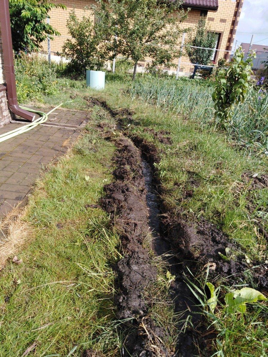 Белгородка вынуждена копать траншеи, чтобы спасти дом от подтопления, фото-5